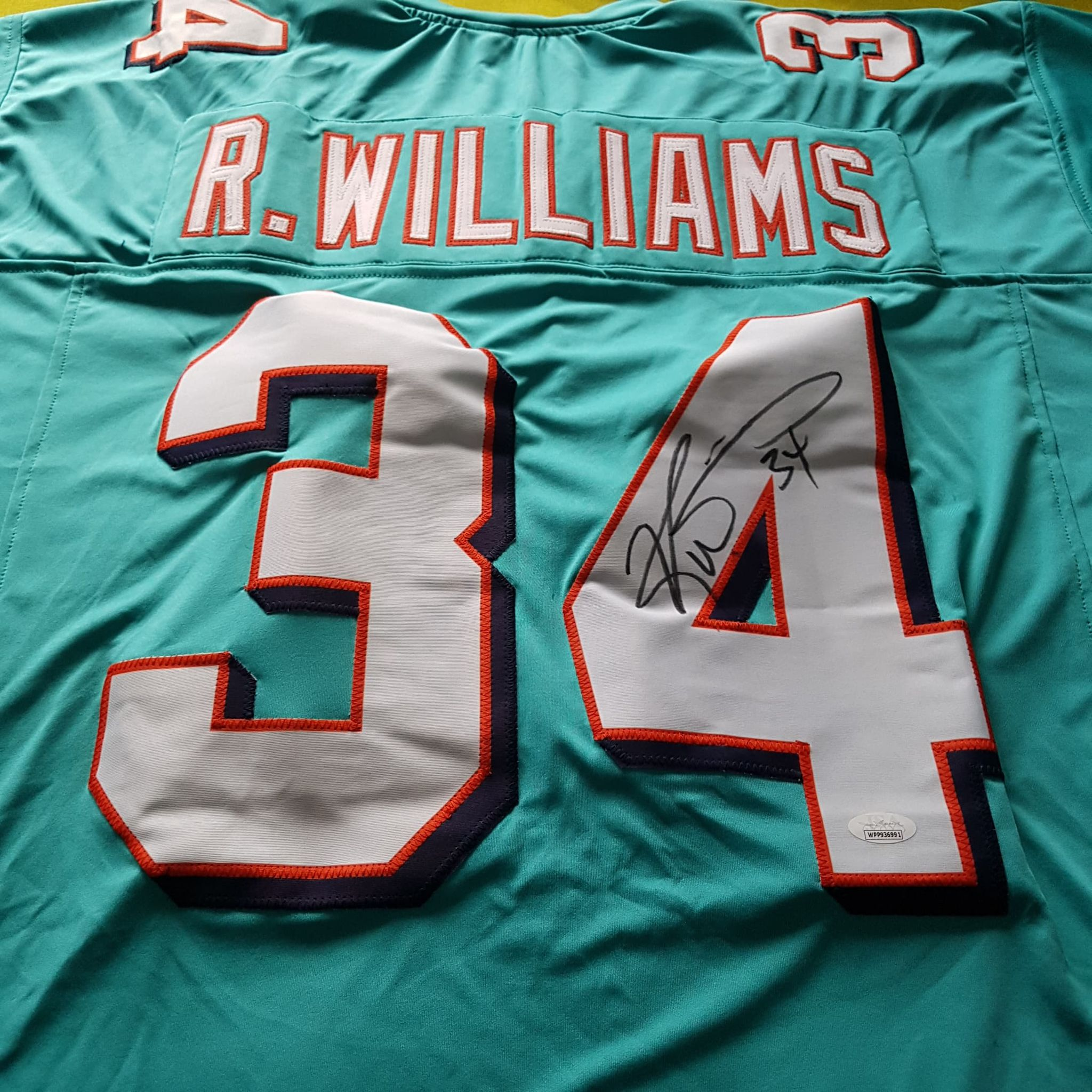 Ricky Williams - Miami Dolphins Running Back - Signed Jersey (JSA Certificate of Authenticity)